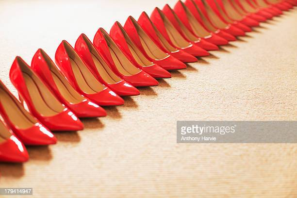 Close up of red shoes in a row