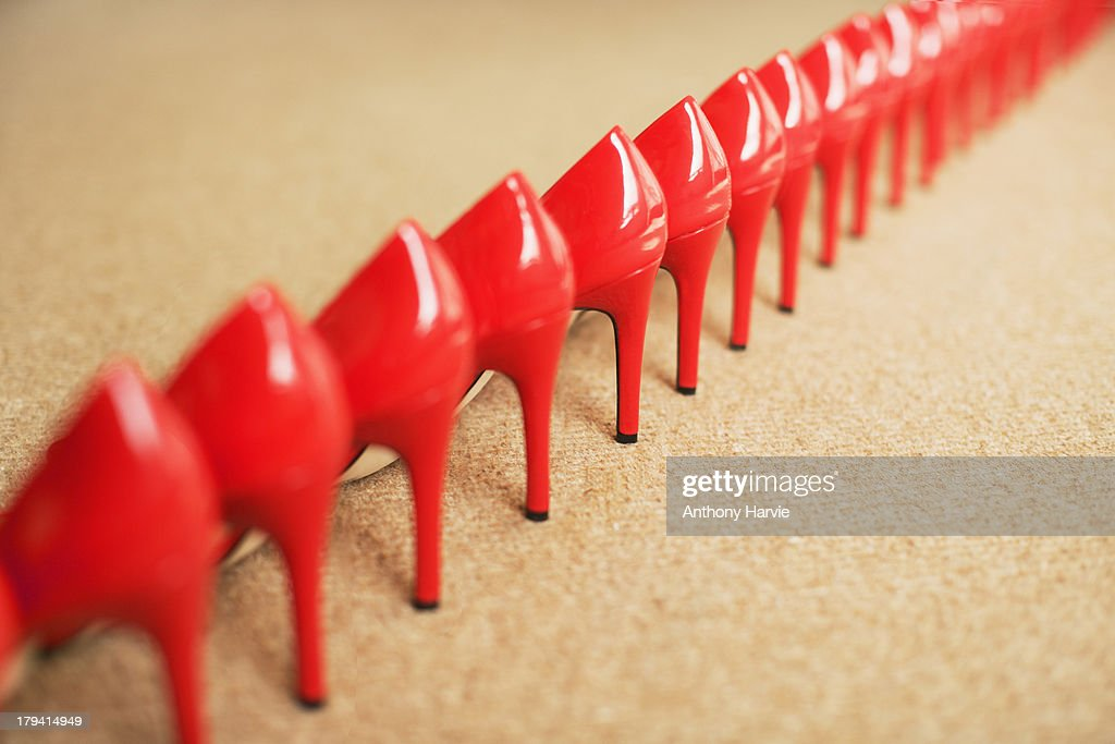 Close up of red shoes in a row, rear view : Stock Photo
