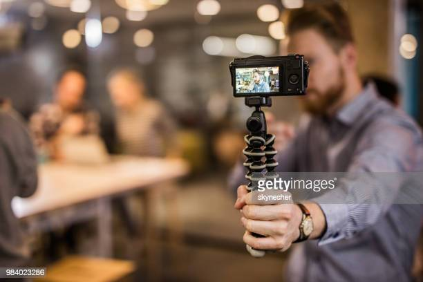 close up of redhead man making reportage by vlogging. - influencer stock pictures, royalty-free photos & images