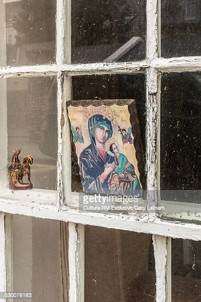 Close up of religious icon in house window, Dingle, County Kerry, Ireland