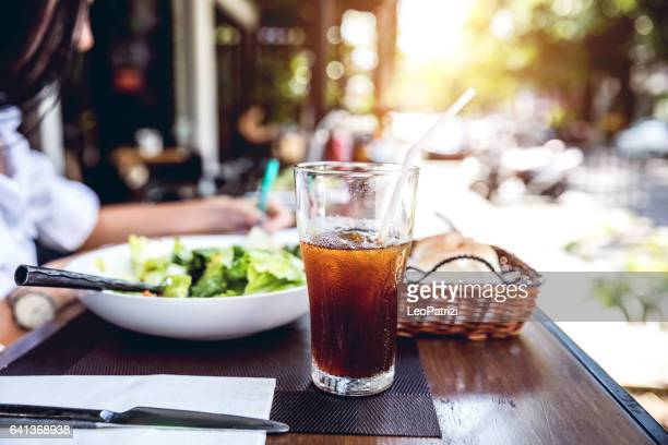 Close up of restaurant table with a soda drink