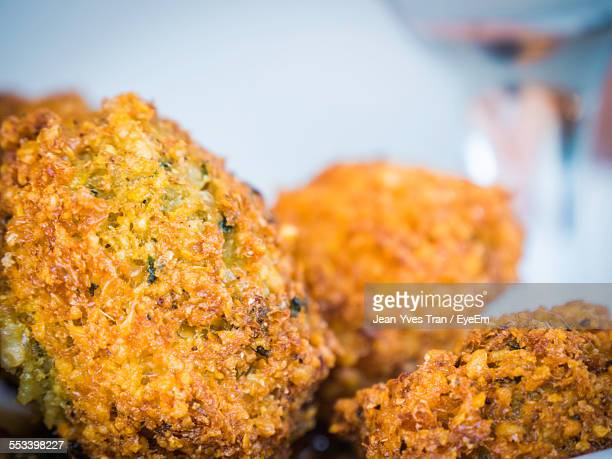 close up of rice croquettes - croquette stock photos and pictures