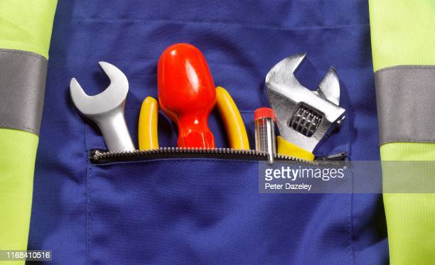 close up of roadside rescue mechanic's pocket - support stock pictures, royalty-free photos & images