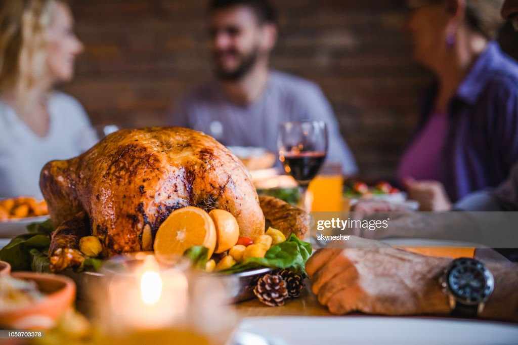 Close up of roasted turkey on family's' dining table. : Stock Photo