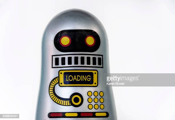 Close up of robot with program loading on white background