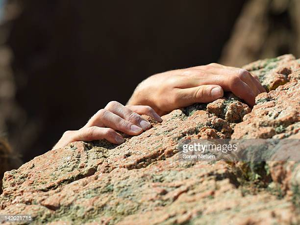 Close up of rock climbers hands
