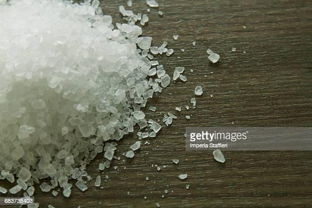 Close up of rock salt on wooden surface