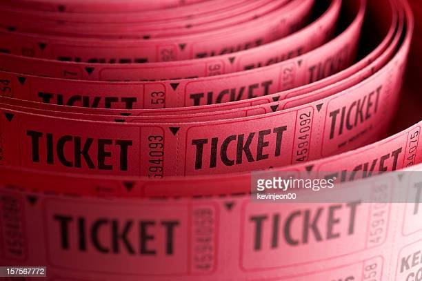 Close up of roll of pink ticket stubs