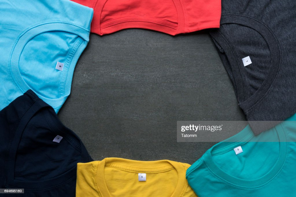 close up of rolled colorful clothes on black background : Stock Photo