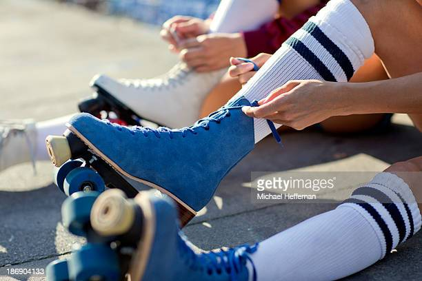close up of rollerskates being laced up - blue shoe stock pictures, royalty-free photos & images