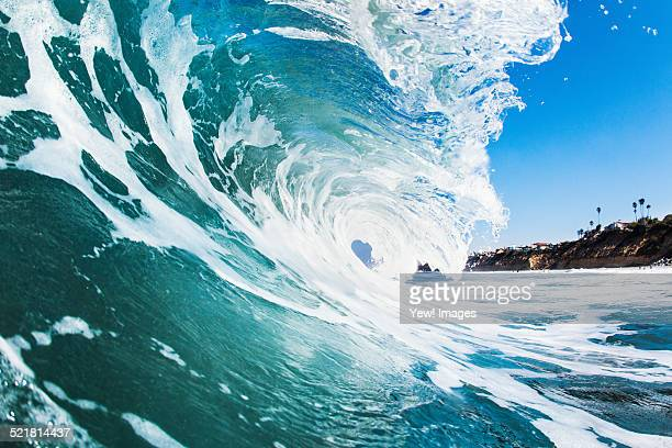 close up of rolling wave and foamy sea - california beach stock pictures, royalty-free photos & images