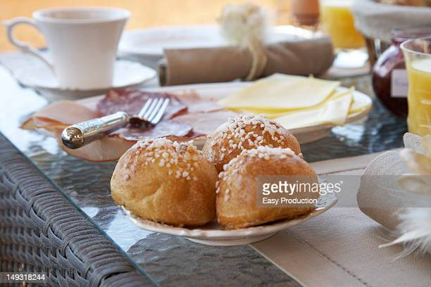 Close up of rolls at breakfast table