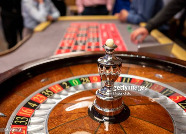 close up of roulette wheel at the casino - casino stock pictures, royalty-free photos & images