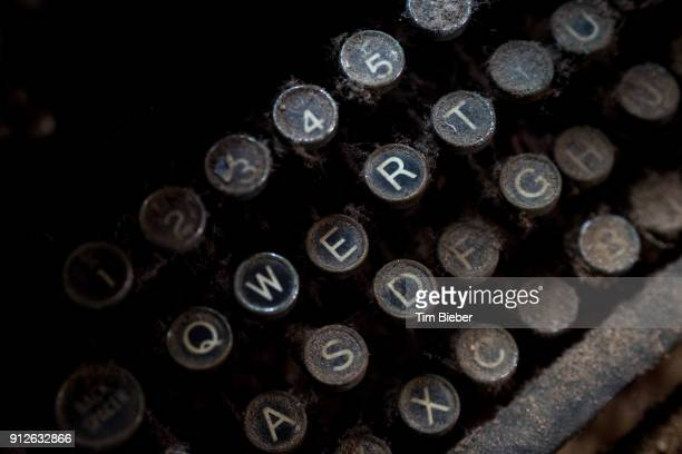 Close up of round letter keys on an old dusty typewriter