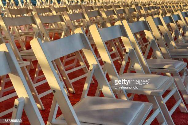 close up of rows of chairs. - emreturanphoto stock pictures, royalty-free photos & images