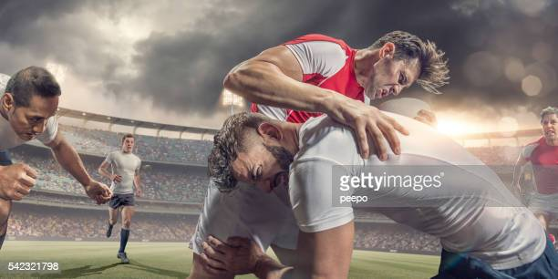 close up of rugby player tackled hard during match - tackling stock pictures, royalty-free photos & images