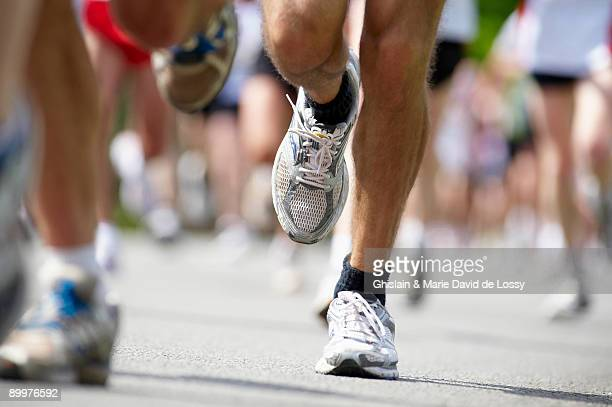 close up of running feet - marathon stock pictures, royalty-free photos & images