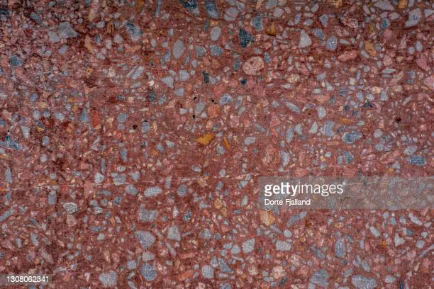close up of rusty red, old terrazzo with spots of grey - dorte fjalland stock pictures, royalty-free photos & images