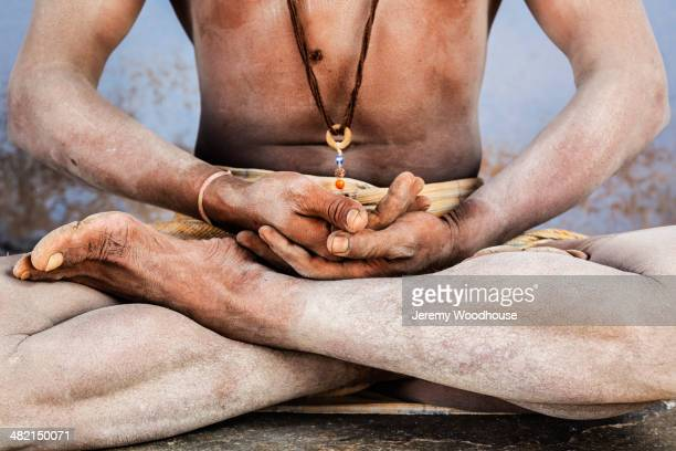 Close up of Sadhu in lotus position