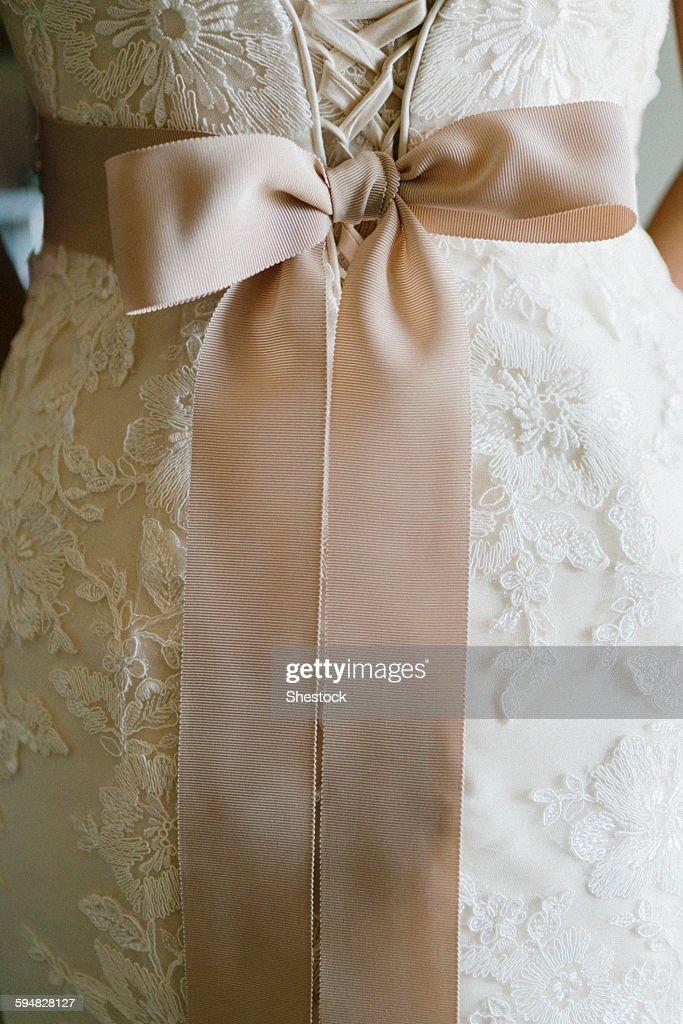 Close up of sash on wedding dress : Stock Photo