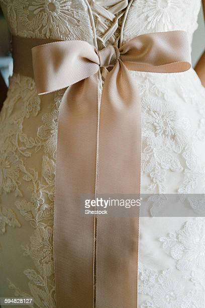 Close up of sash on wedding dress