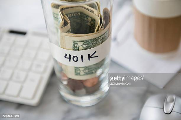 Close up of savings cup on office desk