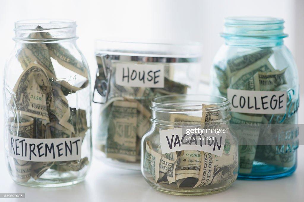 Close up of savings jars with money : Stock Photo