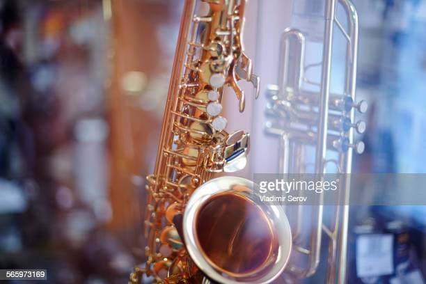 Close up of saxophone and trombone