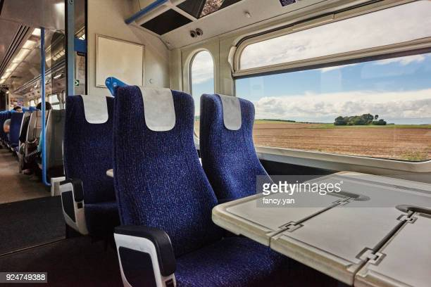 close up of seat in the railway carriage - vehicle seat stock pictures, royalty-free photos & images