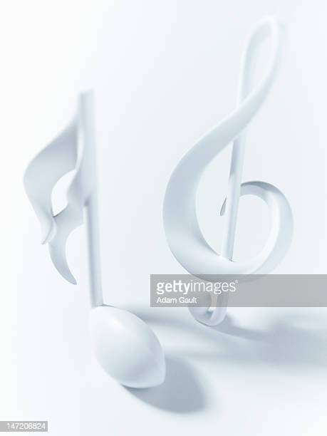 close up of semiquaver and treble clef musical notes on white background - chiave di violino foto e immagini stock