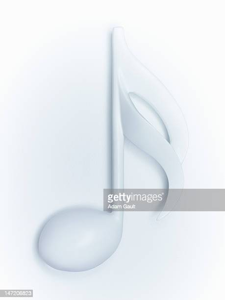 close up of semiquaver musical note on white background - musical note stock photos and pictures