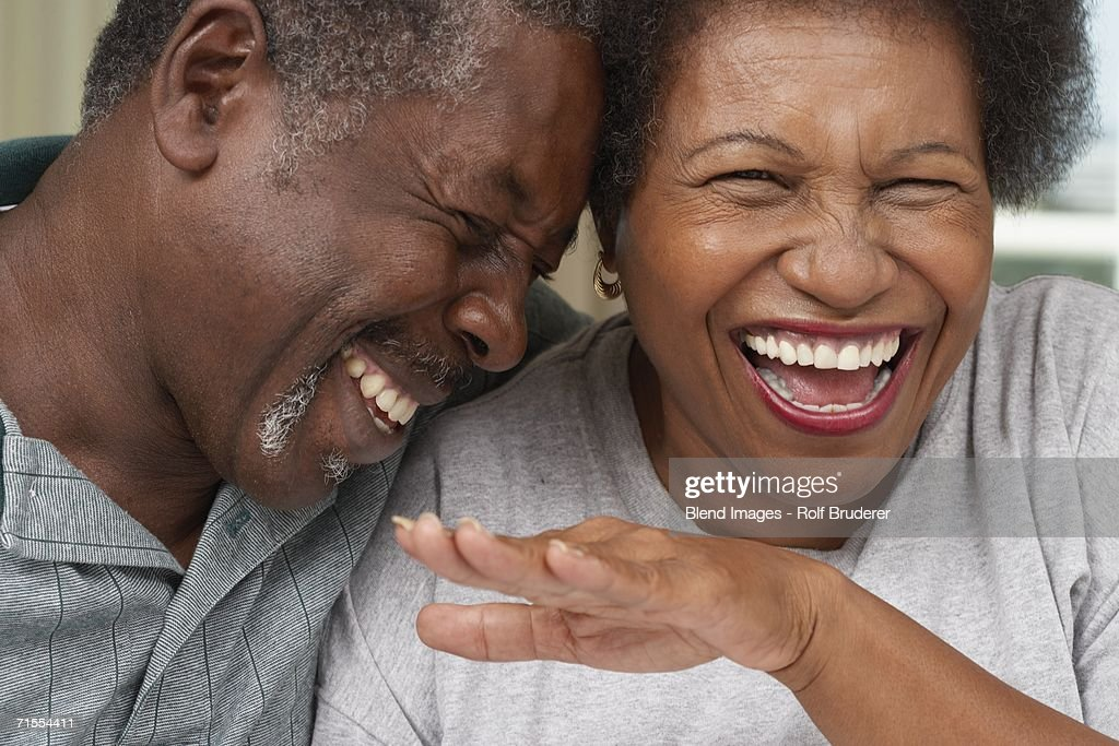 Close up of senior African American couple laughing : Stock Photo