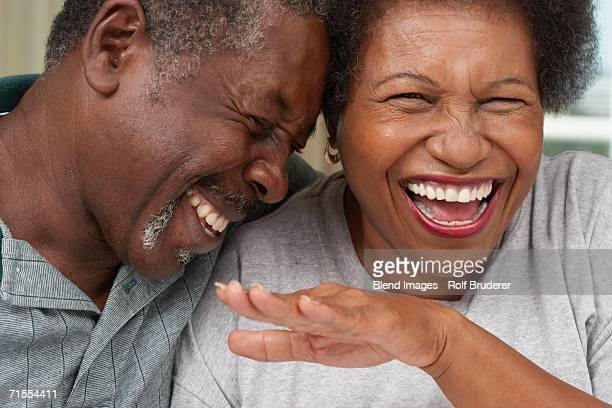 close up of senior african american couple laughing - black people laughing stock photos and pictures