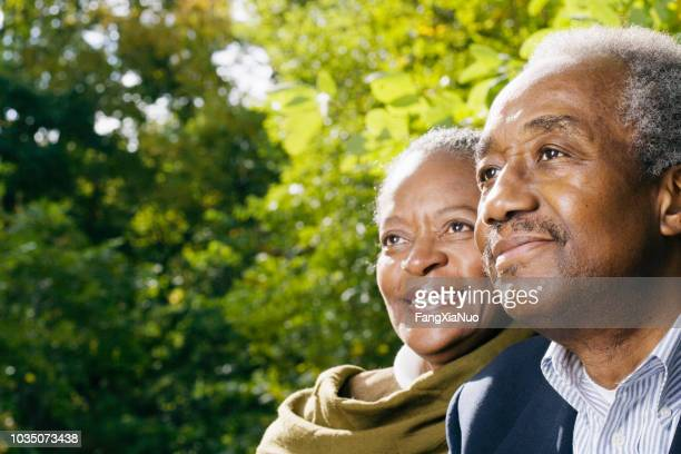 close up of senior african couple smiling outdoors - contemplation couple stock pictures, royalty-free photos & images