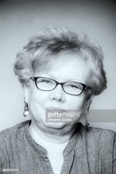 Close up of senior Caucasian woman wearing eyeglasses