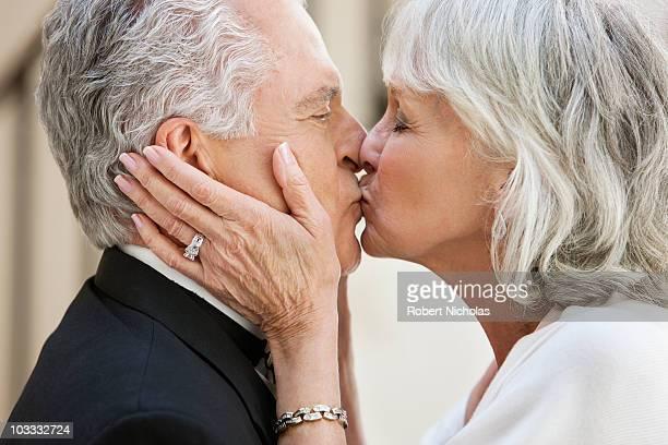Close up of senior couple kissing