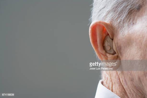 Close up of senior Hispanic man¿s hearing aid