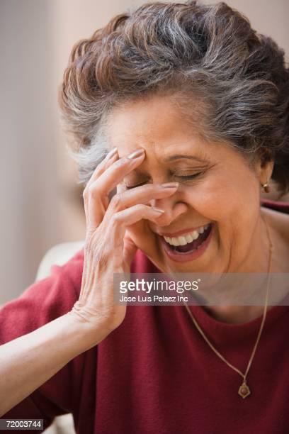 Close up of senior Hispanic woman laughing