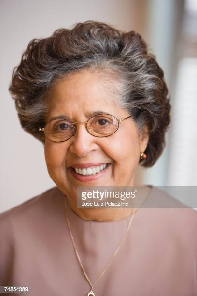 Close up of senior Hispanic woman smiling