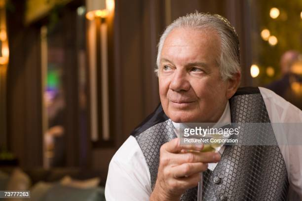 Close up of senior man drinking cocktail