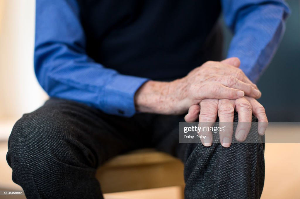 Close Up Of Senior Man Suffering With Parkinsons Diesease : Stock Photo