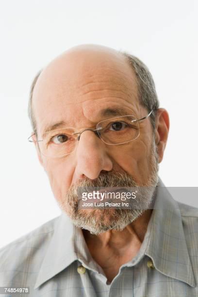Close up of senior man wearing eyeglasses