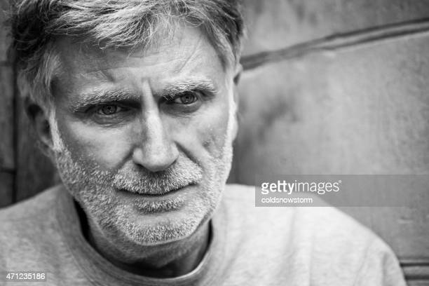 close up of senior man with beard sitting in doorway - addict stock photos and pictures