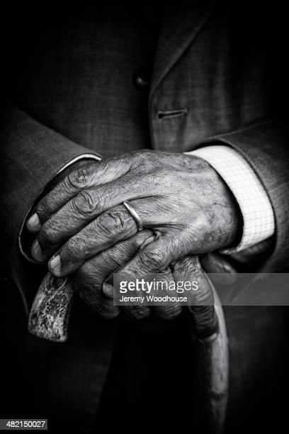Close up of senior man's hands on cane