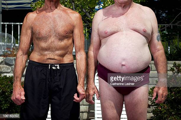 close up of senior men in swimming suits - fat man speedo stock pictures, royalty-free photos & images