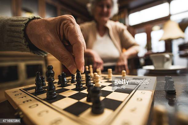 close up of senior playing chess. - playing chess stock pictures, royalty-free photos & images