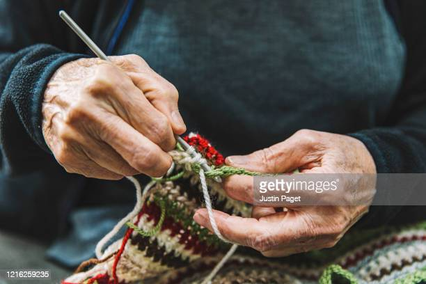 close up of senior woman crocheting - knitting stock pictures, royalty-free photos & images