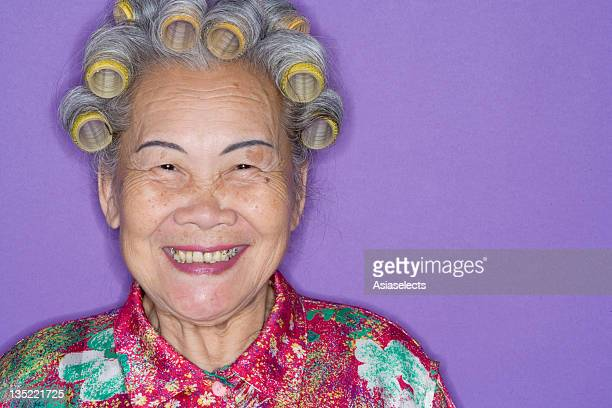 Close up of senior woman in curlers.