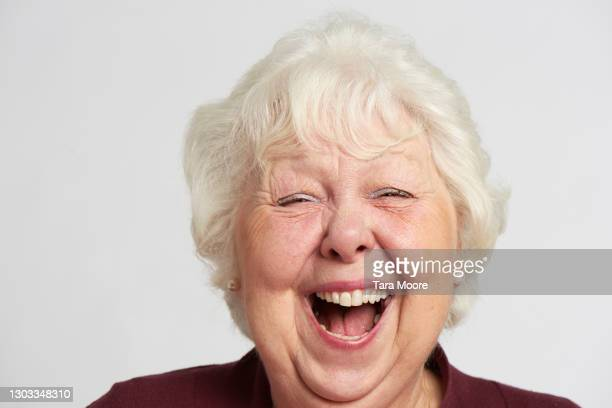 close up of senior woman laughing - laughing stock pictures, royalty-free photos & images