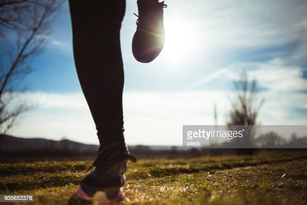 close up of senior woman running - human leg stock pictures, royalty-free photos & images